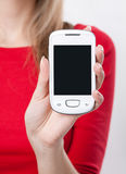 Female hand holding mobile phone Royalty Free Stock Image