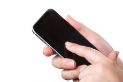 Female hand holding modern black mobile smart phone with blank screen isolated on a white background Royalty Free Stock Photography