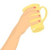 Female hand holding a mug Stock Images