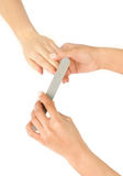 Female hand holding a nail file Stock Image