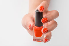 Female hand is holding nail polish Royalty Free Stock Images