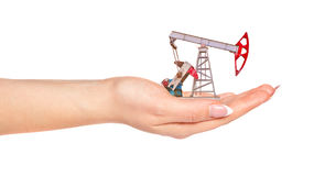 Female hand holding the oil pump. Royalty Free Stock Images