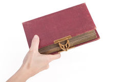 Female hand holding an old book with lock Stock Image