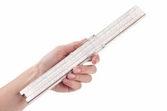 Female hand holding old slide rule Stock Images