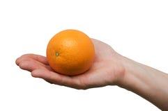 Female hand holding an orange isolated Royalty Free Stock Photography