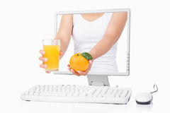 Female hand holding orange and juice Stock Image