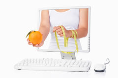 Female hand holding orange and measuring tape Stock Photography
