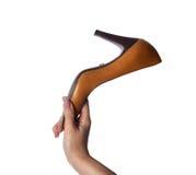 Female hand holding orange shoe. On a white background Stock Photos