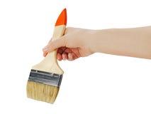 Female hand holding paint brush isolated on white background. Stock Image