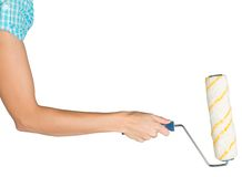 Female hand holding paint roller Royalty Free Stock Photography
