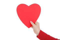 Female Hand Holding a Paper Heart Royalty Free Stock Photography