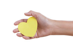 A female hand holding paper heart, Stock Images