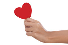 A female hand holding paper heart, Stock Image