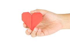 Female hand holding paper heart Stock Photos