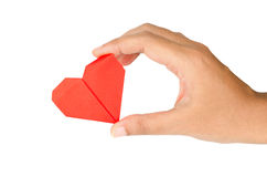 Female hand holding paper heart Royalty Free Stock Photo
