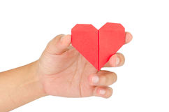 Female hand holding paper heart Royalty Free Stock Photos