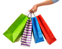 Female hand holding paper shopping bags isolated on white Stock Image