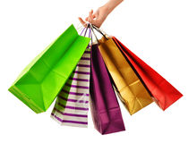 Female hand holding paper shopping bags isolated on white Royalty Free Stock Photography