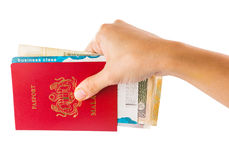 Female Hand Holding Passport and Currency I Stock Images