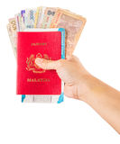 Female Hand Holding Passport and Currency III Royalty Free Stock Images