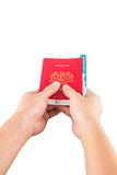 Female Hand Holding Passport and Currency IV Stock Image
