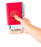 Female Hand Holding Passport and Currency V Stock Photos