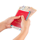 Female Hand Holding Passport and Currency X Stock Image
