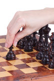 Female hand holding a pawn on the chessboard Royalty Free Stock Image