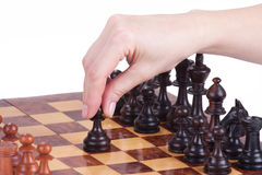 Female hand holding a pawn on the chessboard Stock Photo
