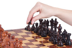 Female hand holding a pawn on the chessboard Stock Image