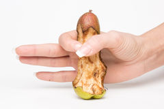Female hand holding a pear-like penis Royalty Free Stock Image
