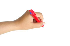 Female hand holding pen to white something isolated Royalty Free Stock Images