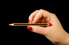 Female hand holding pencil isolated Stock Image