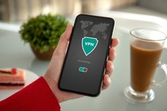 Woman hands holding phone with app vpn private network stock photo