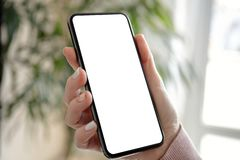 Female hand holding a phone with an isolated screen stock images