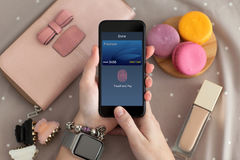 Female hand holding phone with online shopping touch and pay Stock Photo