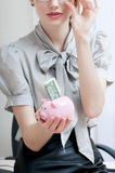 Female hand holding piggy bank. Stock Image