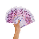 Female hand holding pile of euros Stock Photo