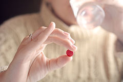 Female hand holding a pill. Close-up of female hand holding a pill. Healthcare concept Royalty Free Stock Photo