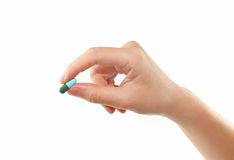 Female hand holding pill isolated Stock Image