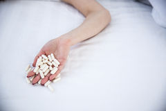Female hand holding pills Stock Photos