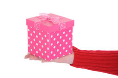 Female Hand Holding a Pink Gift Box Royalty Free Stock Image