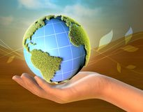 Female hand holding planet Earth stock images