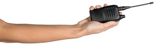Female hand holding portable radio transmitter Stock Images
