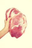 Female hand holding raw pork meat. Royalty Free Stock Images