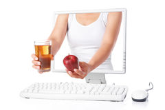 Female hand holding red apple and juice Royalty Free Stock Photography