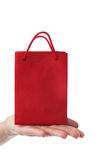 Female hand holding red gift bag Stock Photos