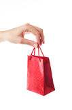 Female hand holding red gift bag Stock Photography