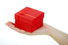 Female hand holding a red gift box Royalty Free Stock Photos
