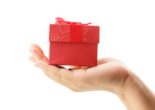 Female hand holding red gift box on white background Royalty Free Stock Image